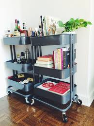Two ikea raskog carts house our bar, our favorite cookbooks, and my home  office