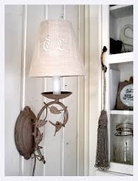 lamp shade with a reused monogrammed tea towel you can find ones at flea markets or you might have some old ones with holes in it at home