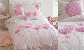 graceful white and pink kids bedding ideas with embroidered pink flower ornament and pink round area