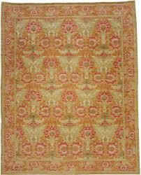 a green and red rug carpet available through david e adler inc