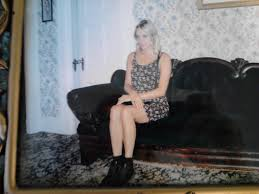 this photograph of chloe sitting on the sofa not the original but very close to it visually where andrew borden d can be found on the wall of the gift