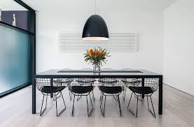 view in gallery ultra modern dining room with oversized light fixture
