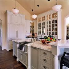 lighting kitchen sink kitchen traditional. traditional kitchen with raised panel carrera marble countertop pendant light high ceiling lighting sink