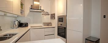 fitted kitchens for small spaces. White Compact Handleless Kitchen Fitted Kitchens For Small Spaces O
