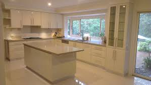 kitchen design with island. fascinating white modern kitchen design with island applying sleek ceramics flooring completed sectional cupboard equipped