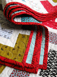 Hand Sewn Binding Tutorial & Red Bordered Quilt Folded Adamdwight.com