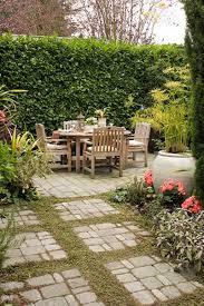 a flagstone patio with garden edging