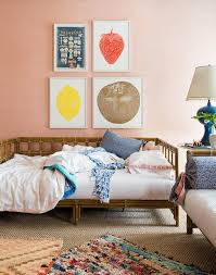 rattan daybed with pink fringe bedding