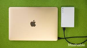 the new macbook charging up from a mophie external battery pack