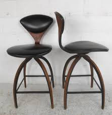 pair of midcentury modern plycraft bar stools by norman cherner