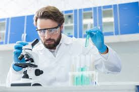 Image result for good looking guy working in lab