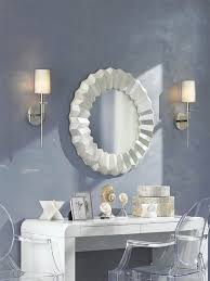 next wall lighting. Wall Lamps Are Installed Next To A Circular Modern Mirror. Wall Lighting