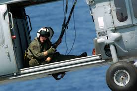 A U S Navy Aircrewman Aboard An Mh 60s Seahawk Helicopter