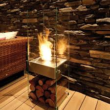 the ecosmart fire ghost is a strikingly elegant almost invisible fireplace fashioned from toughened glass and stainless steel that lavishes design appeal