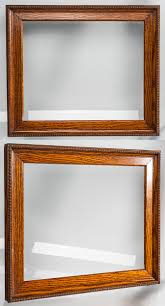 an oak arts crafts style frame with a egg bead around the outside edge it is 12 1 4 x 14 3 4 inches od and has a 10 x 12 inch picture size