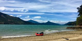 packrafting s marlborough sounds out baggage a packraft sits on a shoreline in mahau sound