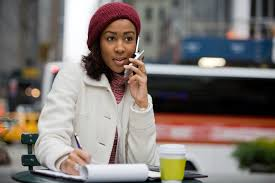 easy tips to ace your next phone interview diversant a mobile business w in the city talks on her cell phone while writing something down