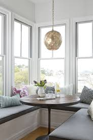 breakfast nook ideas with glass window also grey wall plus modern chandelier for modern dining room