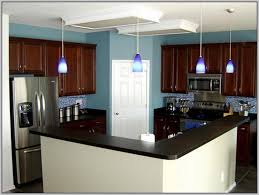 image of kitchen with cherry cabinets