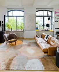 and as jürgen dahlmann s lead designer from rug star says you take a table and a rug and voila you have a dining room