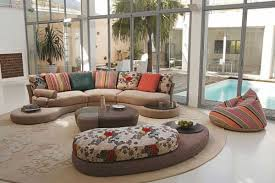 Open View Living Room Using Brown Fabric Curved Sectional Sofa And