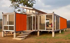 The roof between the two salvaged containers is made from the scrap pieces  of metal cut out to make the windows. The central roof creates a feeling of  ...