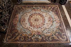 how to keep rug from sliding on hardwood floor best pad for tile floors area rugs slipping travertine pictures marble mosaic art design carpet does retain