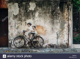 george town malaysia march 21 2016 famous creative penang street art on the wall of unesco heritage buffer zone  on famous wall art in penang with george town malaysia march 21 2016 famous creative penang