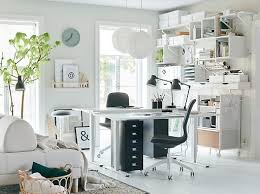 Ikea white office furniture Wooden This Allwhite Home Office Stays Organised With Wall For Storage Using Ikea Ekby Ikea Home Office Furniture Ideas Ikea