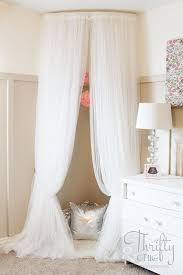 whimsical canopy tent or reading nook made from curved curtain rod and 4 ikea curtains