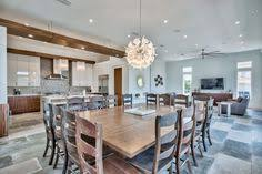 open concept dining room with tile floor and wood finishes