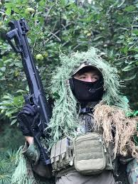 showing off my sru snp 10 in my homemade ghillie suit