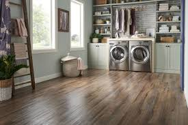 luxury vinyl plank is an affordable waterproof wood look flooring option that has great warmth and texture underfoot and installs with l and stick