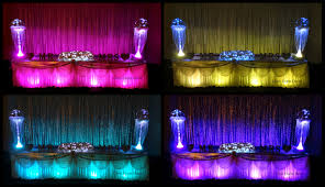 silver sequinned le fairy light wedding bridal backdrop with bridal table skirting with led lighting for