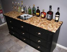 Wine cork dresser top from Decorating Obsessed