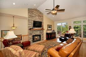 floor to ceiling stone fireplacevaulted ceiling