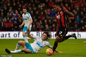 Fabricio Coloccini centre challenges Joshua King right during Newcastle  United versus Bournemouth