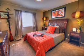 feng shui bedroom colors for with gray curtains and chandelier and wooden nightstand