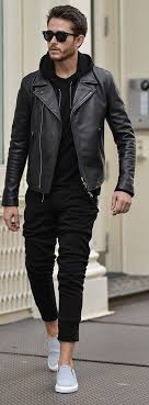 black hoo with black joggers and black leather jacket