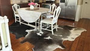 cowhide rugs under table