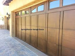 tall garage door installed 2 foot wide by 8 foot tall garage doors with arch gl top and walnut stain yelp tall garage door opener