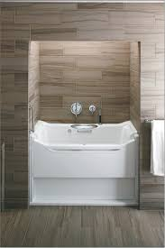 amazing walk in kohler bathtubs with wood tile wall mount with towel rack  for bathroom design