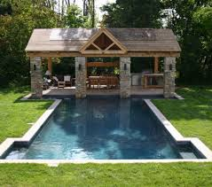 Traditional Patio Design Ideas With Fireplace And Wooden Pergola and