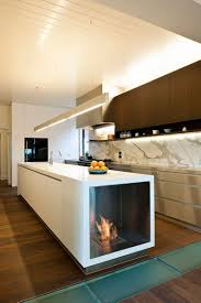 view in gallery stylish contemporary kitchen with fireplace built into the island design ecomodern design