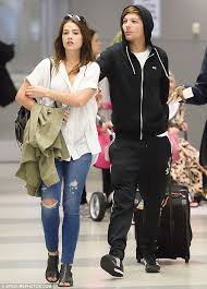 helping hand danielle cbell and louis tomlinson were enjoying some rare travel time together on
