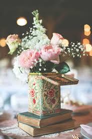 flowers in vine tin and book wedding centerpiece ideas