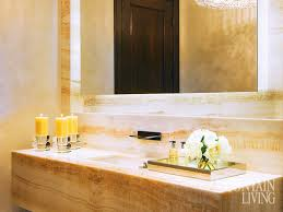 a chandelier by chameleon fine lighting glistens with czech crystals in the powder room the walls and vanity are made from honey onyx