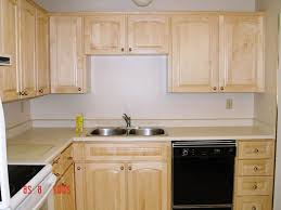unfinished kitchen cabinets cream curved wooden computer desk dark brown wooden countertop green white wall