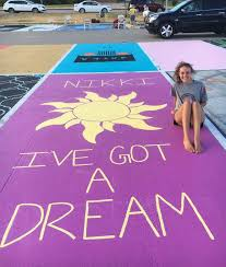 high school seniors paint impressive art in their parking spots