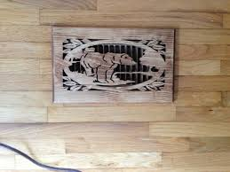 carved wood cover floor vents over laminate wooden floor